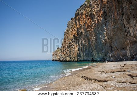 Summer Travel Concept. Landscape With The Beautiful Beach With Rocky Shore. Horizontal Composition.