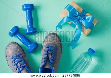 Holiday, Birthday, Party Sport Flat Lay Composition With Blue Dumbbells, Gray Shoes And Plastic Bott