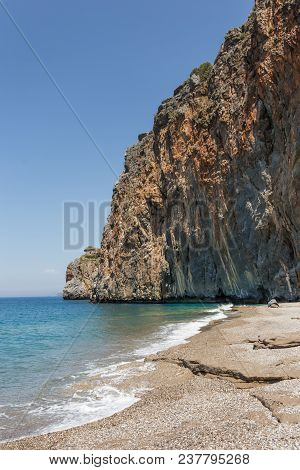 Summer Travel Concept. Landscape With The Beautiful Beach With Rocky Shore. Vertical Composition.