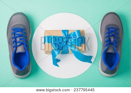 Holiday, Birthday, Party Sport Flat Lay Composition With Blue And Gray Shoes, Gift Box On White Roun