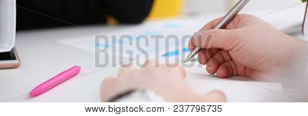 Group Of People Hold Silver Pen Ready To Make Note In Clipboard Pad Sheet Closeup. Training Course U
