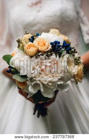 Wedding Bouquet Of White Peonies And Roses In The Hands Of The Bride