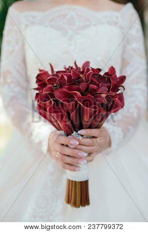 Bride Hold Her Red Calla Wedding Bouquet