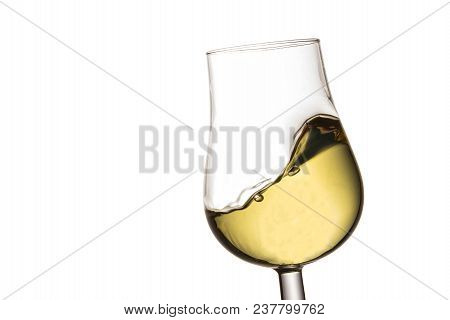 Small Wave Of White Wine In A Glass On A White Background A Delicious Alcoholic Drink Made From Grap