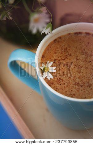 Blue Cup Of Coffee Milk Latte Drink Cinnamon Sticks Wooden Background Rustic Camomile Flower Buquet