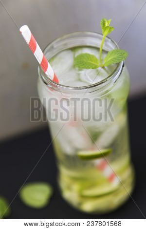 Summer Drink With Ice, Lime And Mint On Dark Background. Closeup
