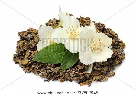 Pile Of Green Tea With Jasmine Flowers Isolated On White Background.