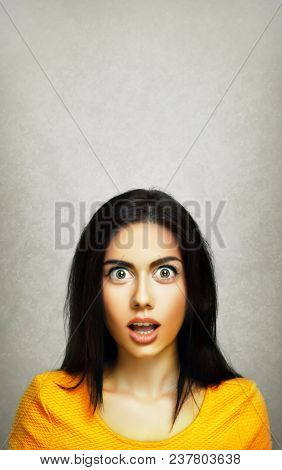 Surprise face expression of young amazed stunned woman