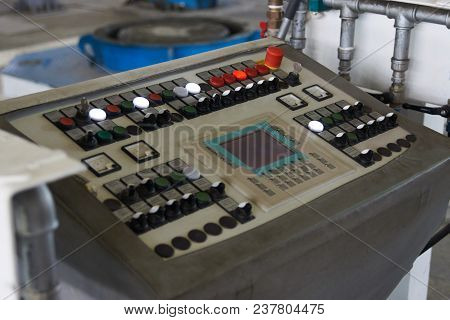 Modern Industrial Control Panel With Buttons, Control Switches And Touchscreen Panel In Control Room