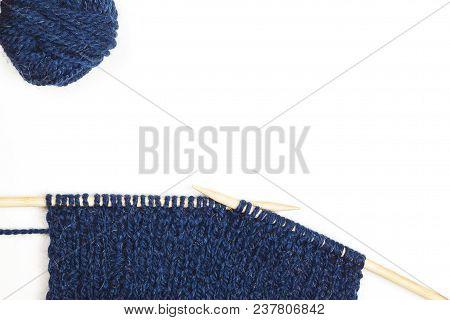 Ball Of Blue Woolen Thread And Knitting Needle Isolated Background. Needlecraft Backgtound