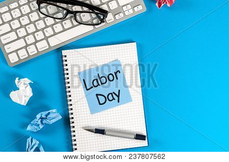 Labor Day - Message On Blue Work Place Background. Labour Day Celebrated At May 1. Spring Time.
