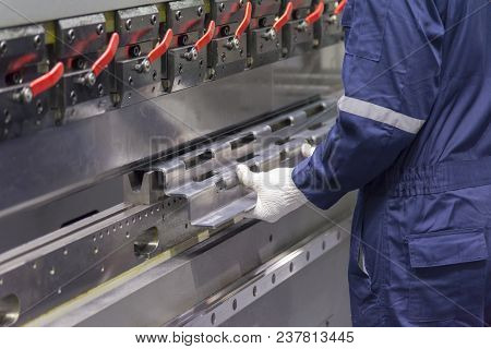 The Technician Operator Use Hydraulic Bending Machine. Metal Working Concept