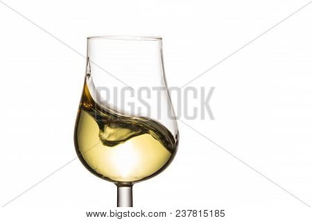 Spectacular Splash In A Glass Of White Wine On A White Background An Appetizing Alcoholic Drink Made