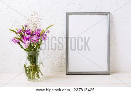 Silver Frame Mockup With Purple Burdocks In Jug