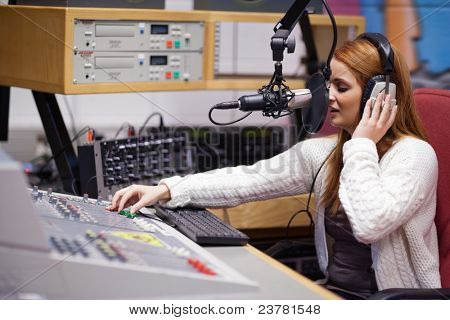 Radio host mixing with a table