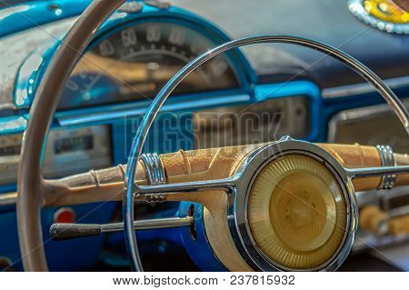 Driver Cockpit And The Steering Wheel Of A Vintage Car