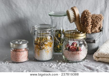Homemade sea salt bath - calendula, pink himalayan, rose salt and bath accessories. Health, beauty, regeneration, skin cleansing concept. Flat lay poster