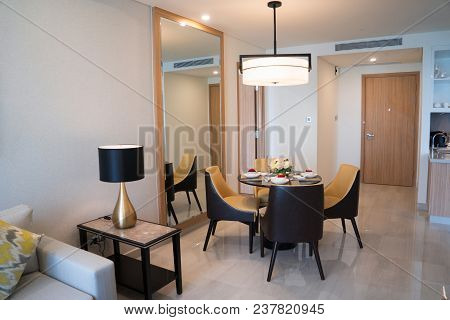 Dining Area Of Comfortable Studio Flat Or Hotel Room. Set Dining Table Prepared For Dinner With Asia