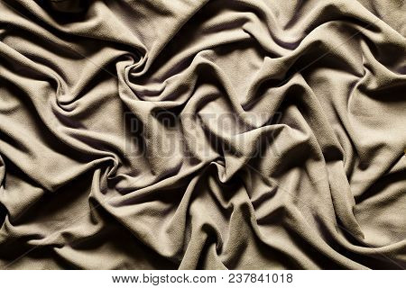 Draping Fabric Cloth Shiny Gray Vintage. Wavy Background. A Fabric With Gray Colored Curves And Wave