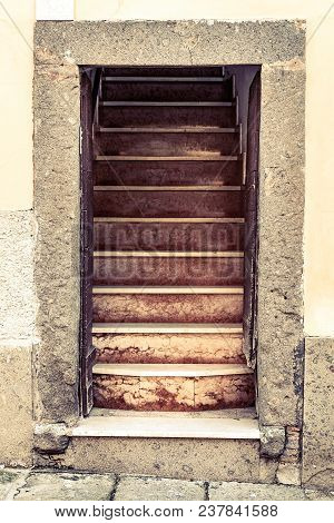 Old Entrance Without A Door To The Entrance Of A Stone House. Stairs Just After Entry. Old Italian M