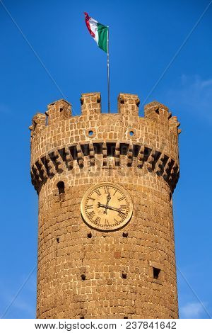Clock tower of the village of Bagnaia. Italy. Bagnaia (little italian village) is a fraction of Viterbo (province of the region Lazio), famous for its garden Mannerist Villa Lante. poster