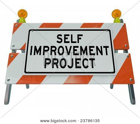 Self Improvement Project words on a road construction barrier to communicate that one is undergoing a procedure or course to improve on the path to success