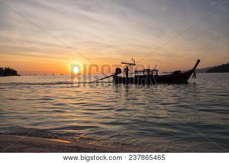 Beautiful View Of Koh Lipe Island,thailand. Silhouette Sunset Sky And Longtail Boat.