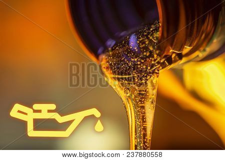 Low Oil Pressure Lamp And Liquid Stream Of Motorcycle Motor Oil Flows From The Neck Of The Bottle Cl