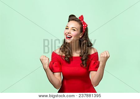 Beautiful Young Woman With Pin-up Make-up And Hairstyle At Studio. Happy, Smiling And Pretty Female