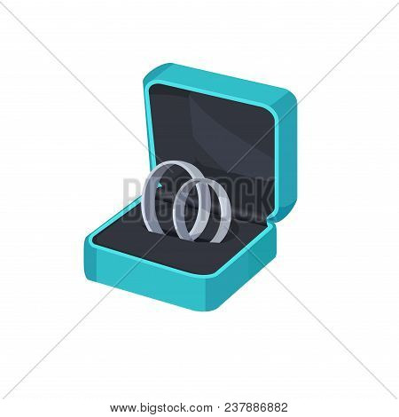 Two Platinum Engagement Rings In Box Isolated On White Background. Wedding Accessories In Blue Packa