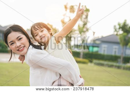 Mother And Daughter Playing In Park Enjoy And Funny Relax Kid Girl Playful Happy Family Lifestyle.
