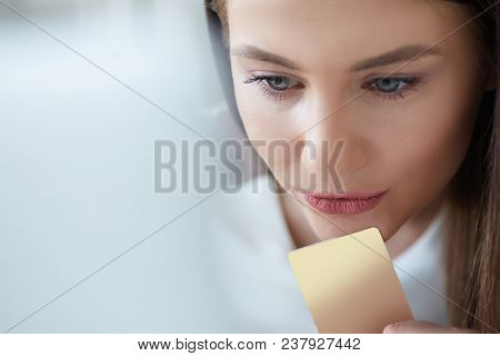 Happy Young Woman Holding A Credit Card And Shopping Online At Home. Beautiful Girl Using Laptop To