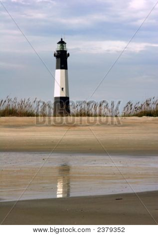 Tybee Lighthouse in Georgia reflected in the wet sands of Tybee Island Beach. poster