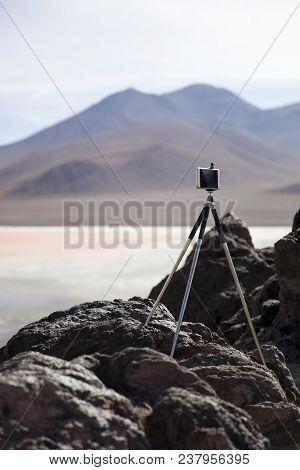 Mobile Phone On The Tripod By Laguna Colorada At Eduardo Avaroa Andean Fauna National Reserve In Bol