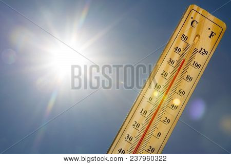 Mercury Thermometer Marking 39 Degrees Celsius 100 Fahrenheit In A Sunny Day. Summer Heat Shown On M