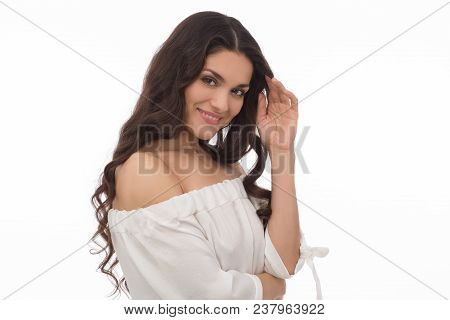 Smiling Brunette Woman Posing N Camera In White Studio. Beauty Concept. Mid Age Woman Over 35 Years