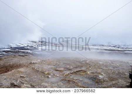 The Steam Contrasts With The Ice And Snow At The Hot Spring In Iceland