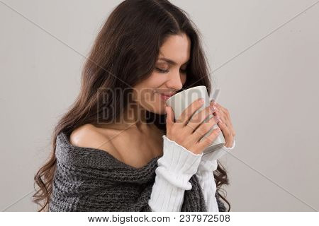 Side View Iamge Of Brunette Woman Having Cup Of Coffee. Wearing Gray Cardigan. Mid Age Woman Over 35