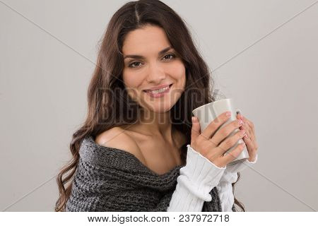 Pretty Brunette Model In Gray Cardigan Holding Cup Of Coffee. Isolated On White Background. Mid Age
