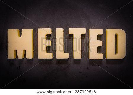 Butter Words Melted With Light Vignette On Cast Iron Skillet