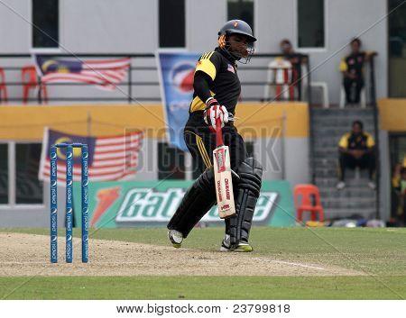 PUCHONG, MALAYSIA - SEPT 24: Malaysia's batsman Ahmad Faiz makes a run in this Pepsi ICC World Cricket League Div 6 finals vs Guernsey at the Kinrara Oval on September 24, 2011 in Puchong, Malaysia.
