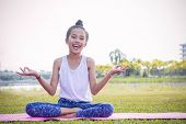 Girl's practicing yoga in the park  Strengthens concentration and health , Yoga for kid have fun Meditation activities for children poster