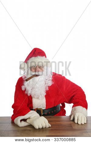 Santa Claus Christmas. Santa enjoys a Fine Cigar while relaxing. Isolated on white. Room for text. Santa enjoys the finer things in life, like Cigars, Hot Coco, Beer, Tequila, Dogs, Cats and more.
