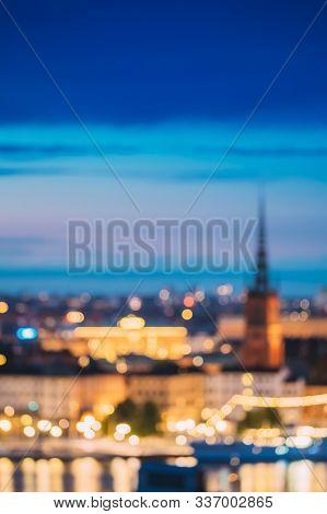 Stockholm, Sweden. Night Skyline Abstract Boke Bokeh Background. Design Backdrop. Riddarholm Church