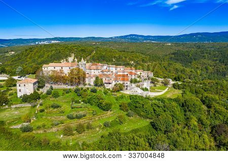Beautiful Old Town Of Hum On The Hill, Countryside Landscape In Istria, Croatia, Aerial View From Dr