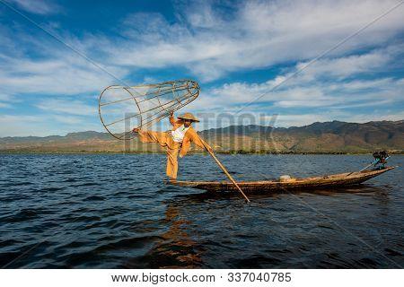 Nyaungshwe Township, Myanmar (burma). January 11, 2019: Intha Fisherman One Leg Stand Pose With Coni