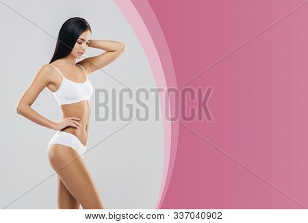 Slender Healthy Girl Posing In White Bodysuit - Copyspace Template. Fit And Sexy Woman In Underwear