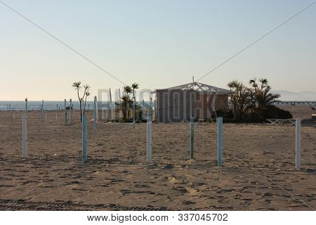 Seaside Resorts In The Winter, Deserted, Desolate. Sandy Beach In Solitude In Versilia