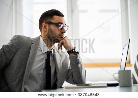 Young Businessman Is Working In His Office.