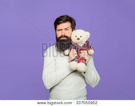 Man With Fluffy Teddy Bear. Holiday Celebration. Gift And Present Concept. Man Holds Teddy Bear Plus